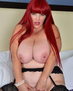 Busty Redhead Milf